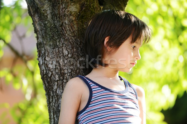 Happy kid outdoors in nature having good time Stock photo © zurijeta
