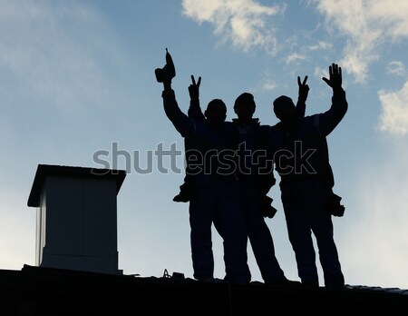 Building roof construction site teamwork silhouette Stock photo © zurijeta