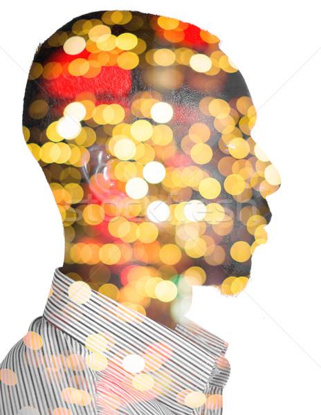 Profile of a man with blurred night lights Stock photo © zurijeta