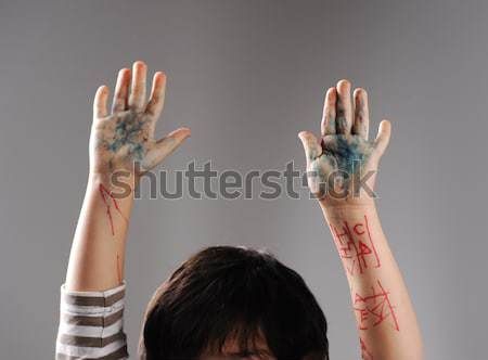 Messy hands, little guilty surrender with hands up Stock photo © zurijeta