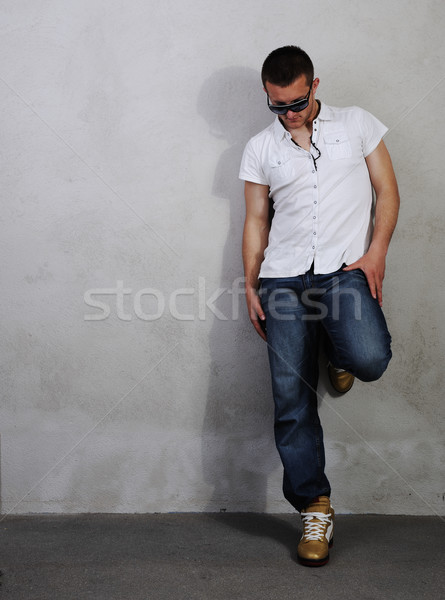Young macho man in different poses, series of photos Stock photo © zurijeta