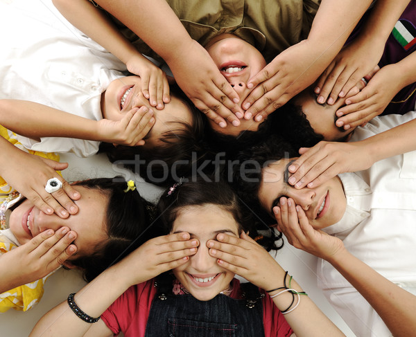happy children group  lying and closing eyes by hands Stock photo © zurijeta