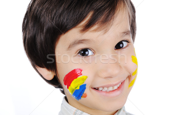 Very positive kid with colors on cheek Stock photo © zurijeta
