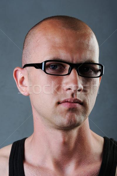 Bald man with glasses in his twenties Stock photo © zurijeta