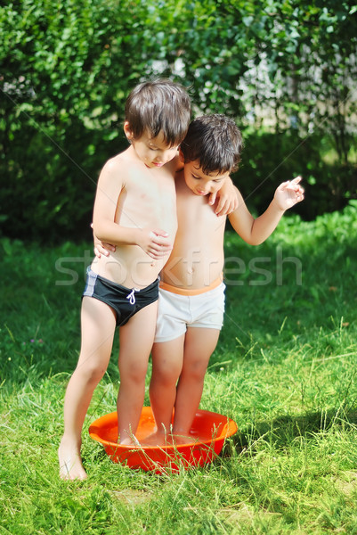 Two kids in basin with water Stock photo © zurijeta