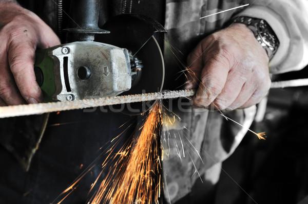 Worker with Electric grinder Stock photo © zurijeta