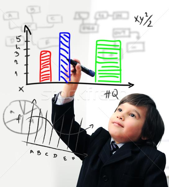 Child drawing  a diagram on digital screen Stock photo © zurijeta