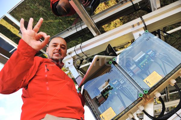 Engineer working with laptop installing  solar panels Stock photo © zurijeta