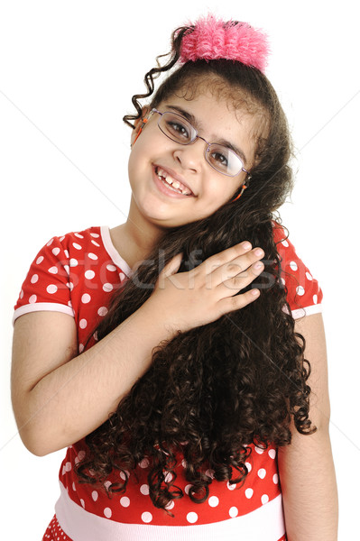 Cute adorable child isolated, female holding her long beautiful hair, mixed race Stock photo © zurijeta