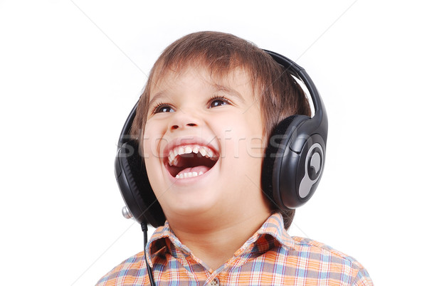 Little nice boy listening to music with peaceful expression on face Stock photo © zurijeta