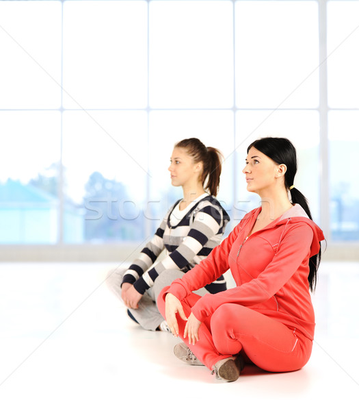 Two girls doing yoga and fitness  in bautiful bright surround  Stock photo © zurijeta