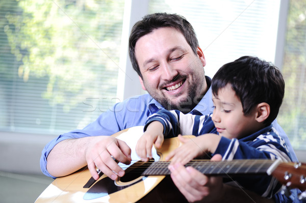 Apa fia játszik gitár otthon család jókedv Stock fotó © zurijeta