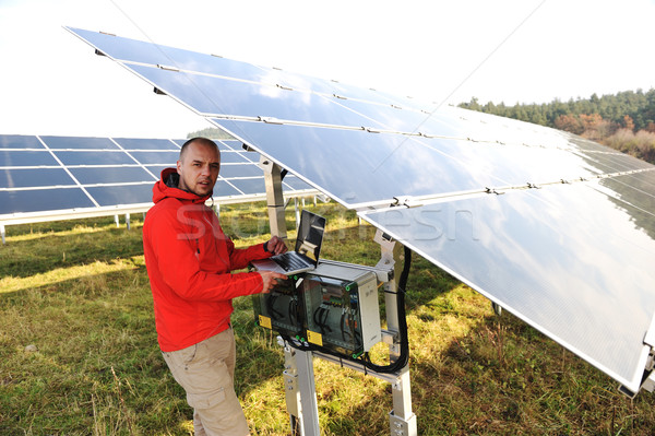 Man working with laptop at solar panels field Stock photo © zurijeta