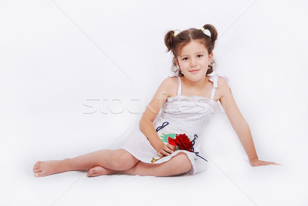 Stock photo: Beautiful scene of a girl with rose