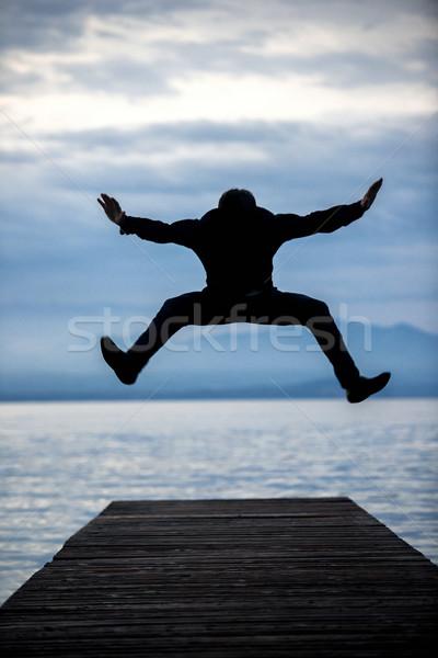 человека прыжки пешеходный мост пусто рассвета воды Сток-фото © zurijeta