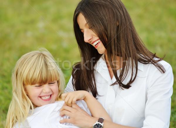 Happy family in nature having fun Stock photo © zurijeta