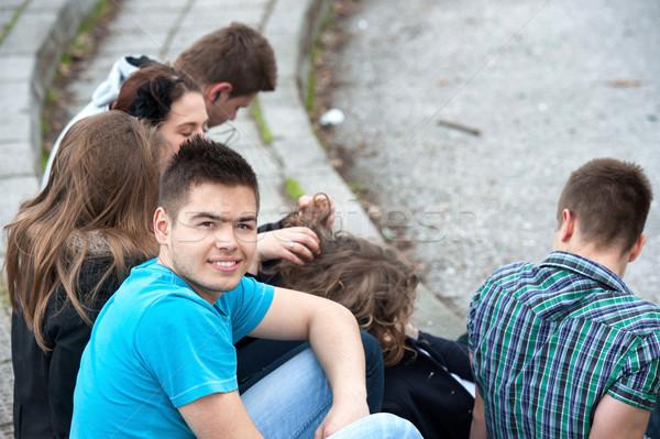 Young people sitting on steps Stock photo © zurijeta