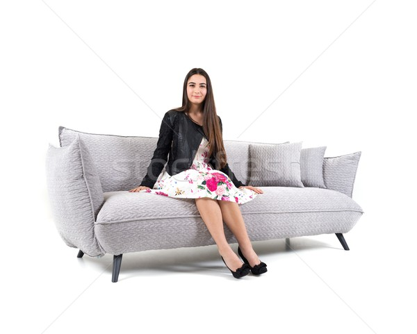 Beautiful young woman on sofa isolated Stock photo © zurijeta