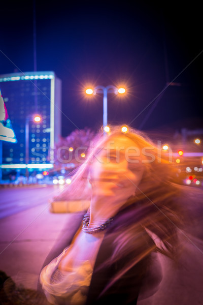 Young woman dancing with hair on the night city street Stock photo © zurijeta