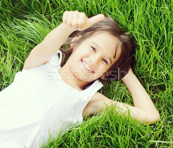Happy little boy enjoying on grass field and dreaming Stock photo © zurijeta