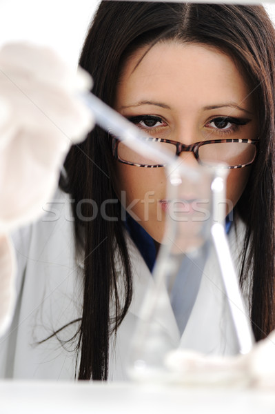 Young beautiful female doctor working with tubes in the lab Stock photo © zurijeta
