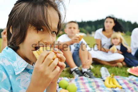 Small group of children in nature eating snacks together, sandwiches, bread Stock photo © zurijeta