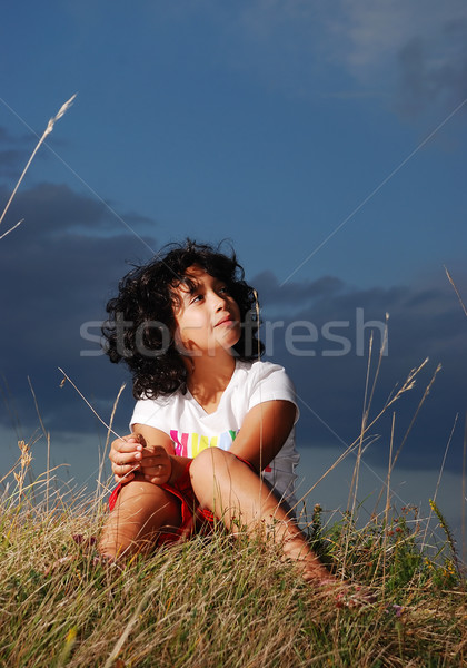 Little girl on meadow, before sunset Stock photo © zurijeta
