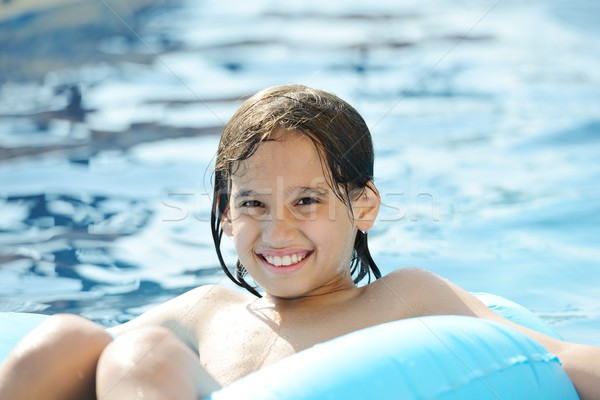 Nino jugando agua verano piscina Foto stock © zurijeta
