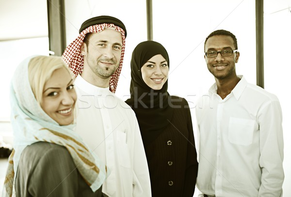 Filtered middle eastern business people working together in mode Stock photo © zurijeta