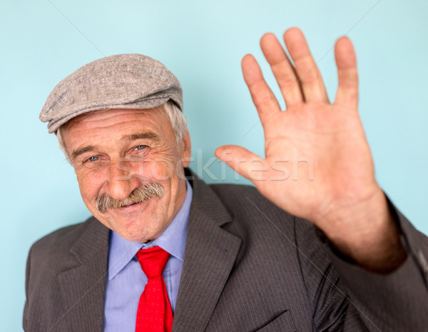 Smiling and confident mature businessman with mustache and gray  Stock photo © zurijeta