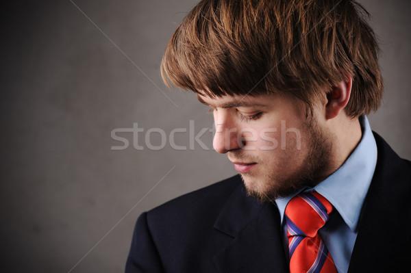 Młody człowiek garnitur działalności człowiek moda tle Zdjęcia stock © zurijeta