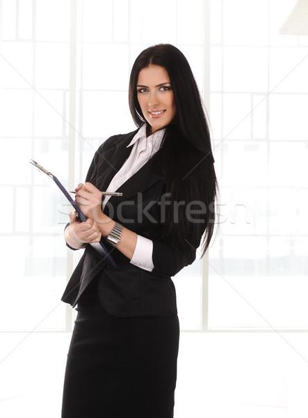 Zakenvrouw documenten handen moderne kantoorgebouw Stockfoto © zurijeta