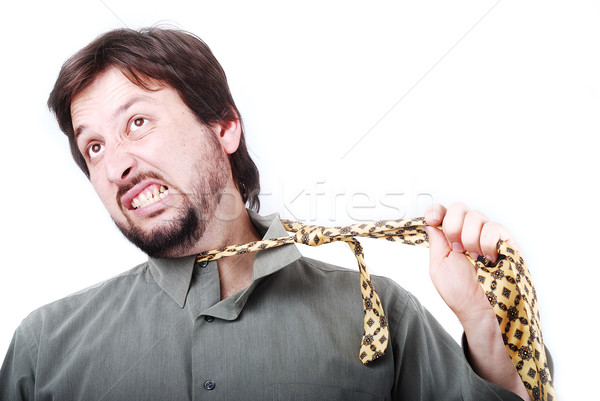 Stock photo: Man wearing shirt and tie with boring and angry expression on his face