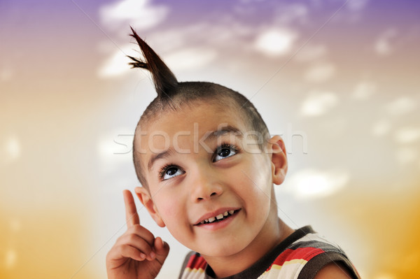 Cute little boy with funny hair and grimace, colorful background Stock photo © zurijeta
