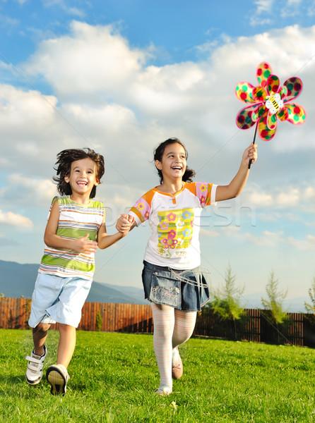 Fantástico escena feliz ninos ejecutando jugando Foto stock © zurijeta