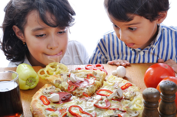 Two children with surprised face on pizza table Stock photo © zurijeta