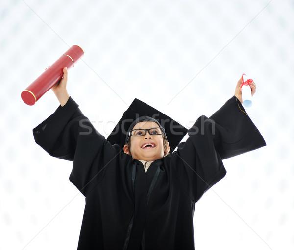 Kid celebrating graduating diploma Stock photo © zurijeta
