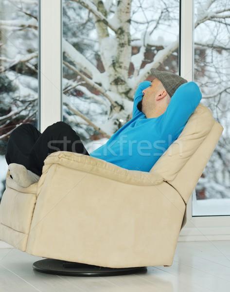 Genç rahatlatıcı beyaz kanepe ev kış Stok fotoğraf © zurijeta