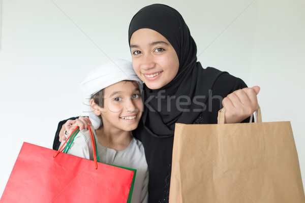 Happy Arabic family having fun time with shopping bags Stock photo © zurijeta