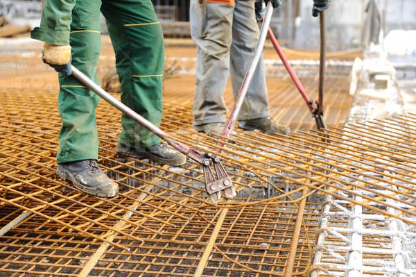 A construction worker hooking up iron beams Stock photo © zurijeta