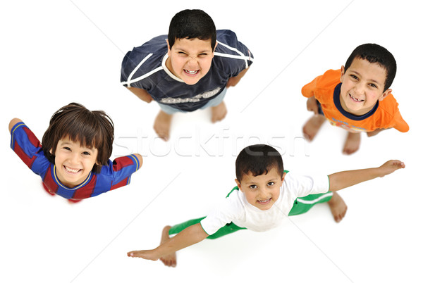 Happy child, positive fresh little smiling boy from above, diffe Stock photo © zurijeta
