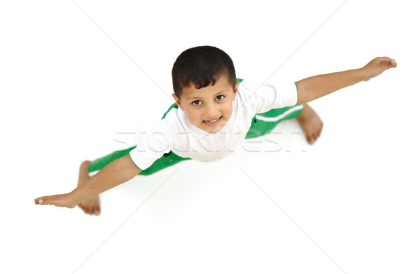 Happy child, positive fresh little boy from above, different angle, isolated on white, opened arms Stock photo © zurijeta