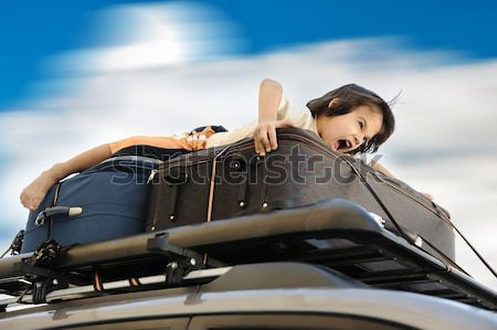 Little boy traveling on the top of the car Stock photo © zurijeta