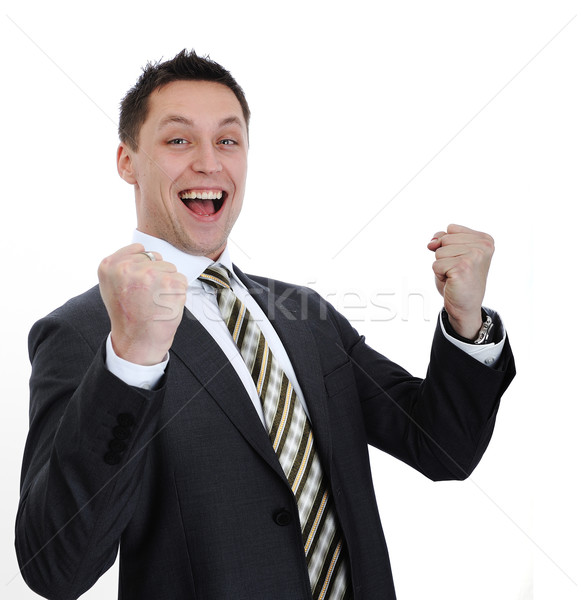 Businessman lifting arms in excitement Stock photo © zurijeta