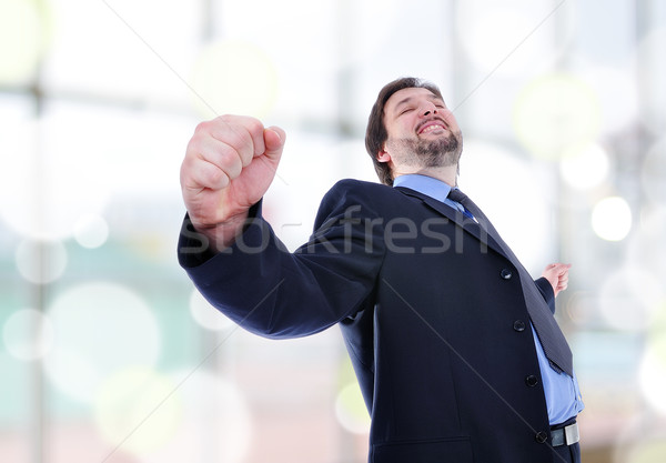 business man standing with fists clenched in victory.  Stock photo © zurijeta