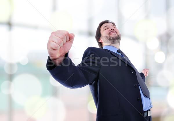 Iş adamı ayakta zafer mutlu arka plan işadamı Stok fotoğraf © zurijeta