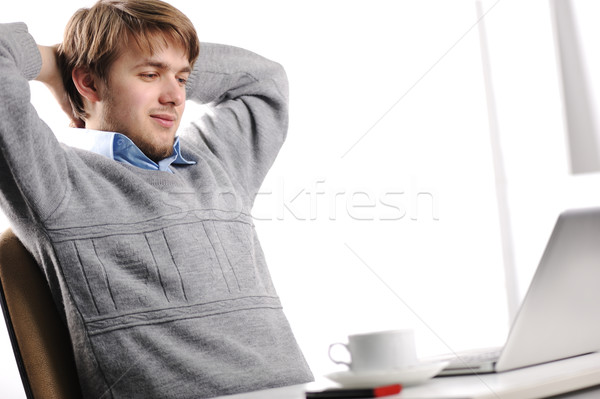 Relaxed young man in office Stock photo © zurijeta