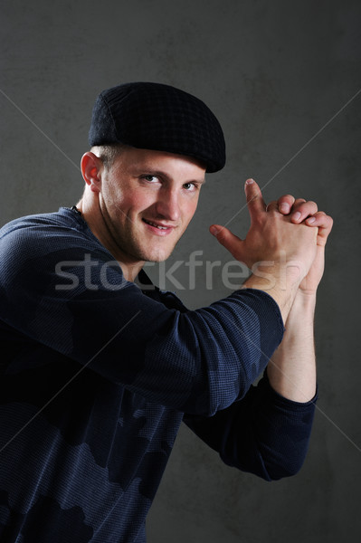 Portrait of young handsome  man  with imagined gun  Stock photo © zurijeta