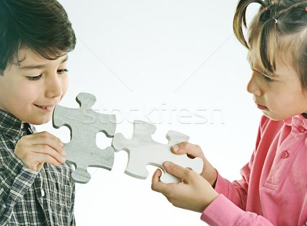 Kids connecting the jigsaw puzzle Stock photo © zurijeta