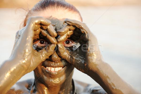 Genieten natuurlijke mineraal modder gezicht Stockfoto © zurijeta